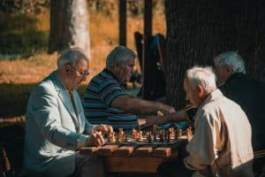 aged people playing chess